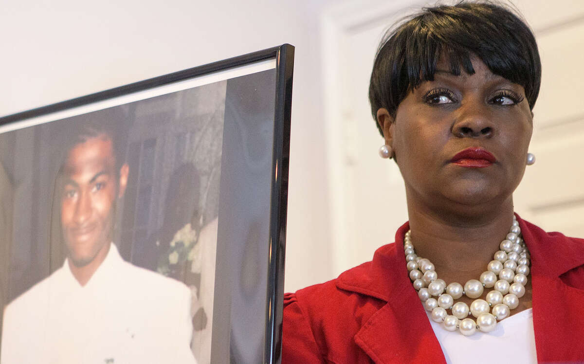 A photo of Danarian Hawkins is seen as his mother, Jacqueline Smith, addresses the media during a news conference, Wednesday, July 29, 2015, in Houston. The Texas Civil Rights Project-Houston announced legal action against the Harris County Sheriff's Office after Hawkins committed suicide while incarcerated at a Harris County jail.