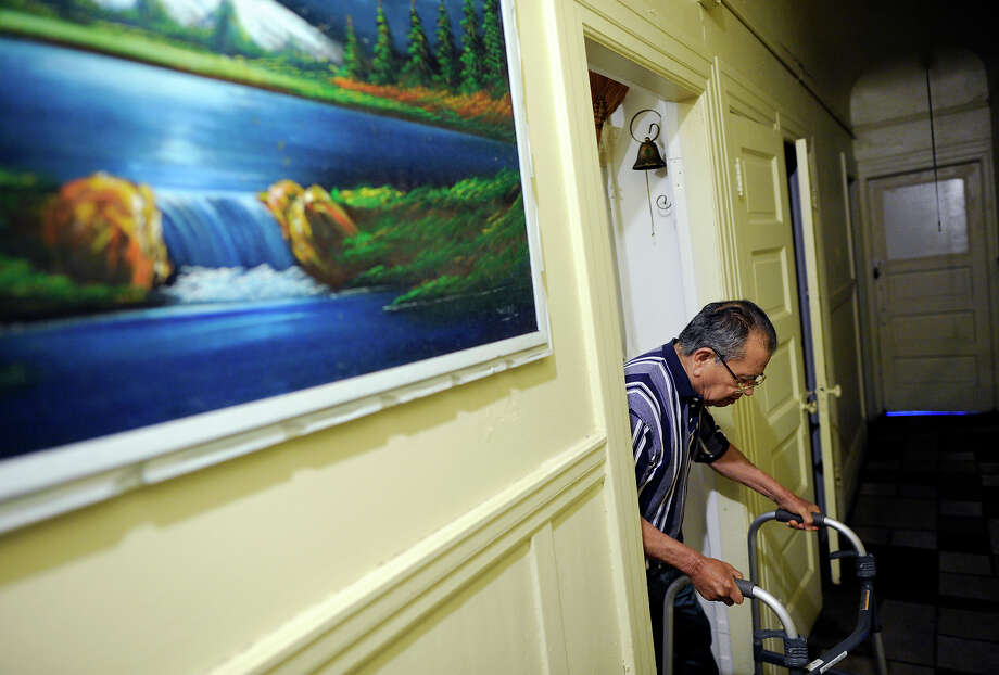 Guillermo Manzanares, 87, walks out of the kitchen of the Mission District apartment he has called home for 50 years. The property's new owner recently gave the longtime building manager an eviction notice. Photo: Michael Short / Michael Short / Special To The Chronicle / ONLINE_YES