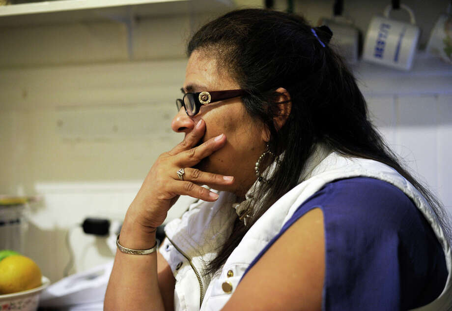 """Manzanares' daughter, Carla Anaya, gets choked up as she talks about her father's fight against eviction. """"It's very, very, very distressing,"""" Anaya said. Photo: Michael Short / Michael Short / Special To The Chronicle / ONLINE_YES"""