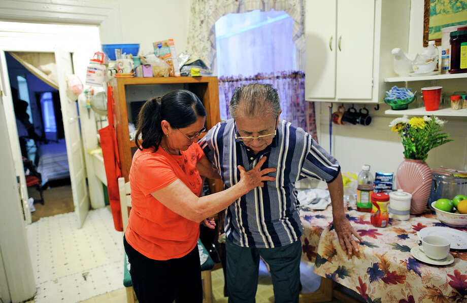 Guillermo Manzanares, 87, is helped by his live-in caretaker, Marta Reyes. Manzanares was told his lease forbids roommates. Photo: Michael Short / Michael Short / Special To The Chronicle / ONLINE_YES