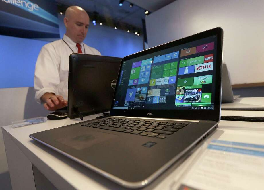 A Dell laptop computer running Windows 10 is on display at the Microsoft Build conference in San Francisco. Microsoft is aiming to build lasting relationships with Windows 10, which is seen as critical to reviving the fortunes of the once-dominant tech giant. Photo: Jeff Chiu /Associated Press / AP