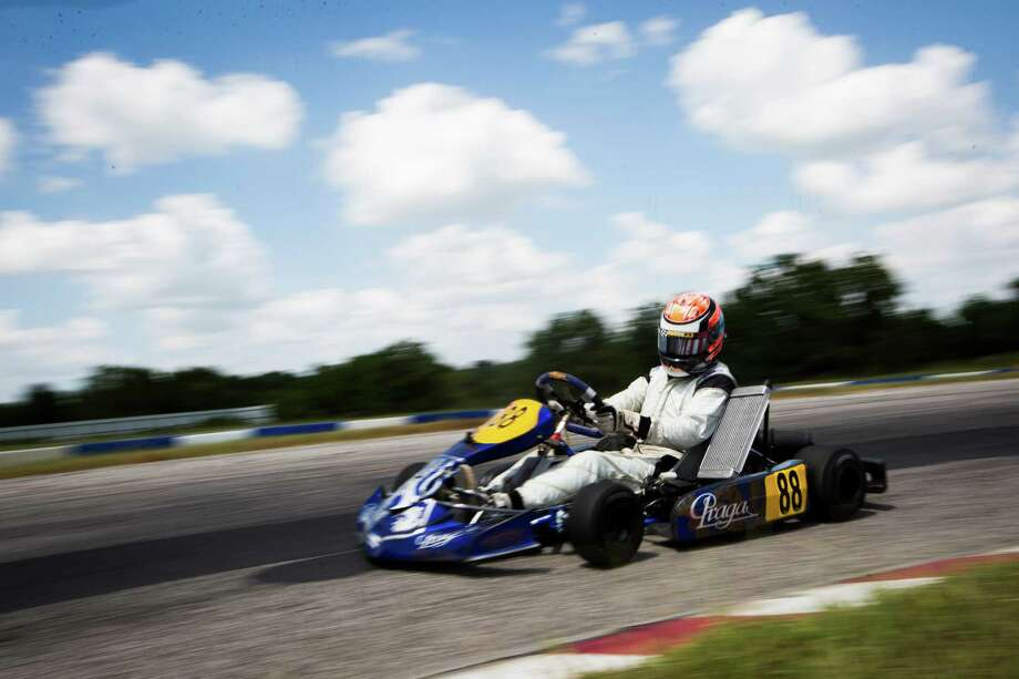 Alec Udell, 19,  drives go-kart during an instruction summer session where Udell is a coach. Friday, July 24, 2015, in Katy. ( Marie D. De Jesus / Houston Chronicle ) Photo: Marie D. De Jesus, Staff / © 2015 Houston Chronicle
