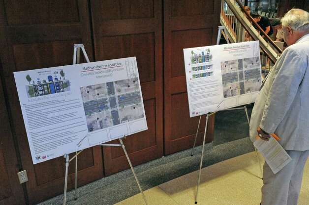 A variety of possible solutions for the Madison Avenue road diet for bicycle accommodations on display during an open fourm at the College of Saint Rose on Wednesday July 29, 2015 in Albany, N.Y. (Michael P. Farrell/Times Union) Photo: Michael P. Farrell / 10032825A