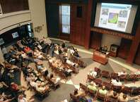 Lindsay Zefting of Alta Planning + Design talks about the Madison Avenue road diet plans for bicycle accommodations during an open fourm at the College of Saint Rose on Wednesday July 29, 2015 in Albany, N.Y. (Michael P. Farrell/Times Union)