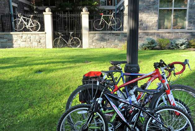 Cyclist bikes parked and locked outside an open fourm about the Madison Avenue road diet plans for bicycle accommodations  at the College of Saint Rose on Wednesday July 29, 2015 in Albany, N.Y. (Michael P. Farrell/Times Union) Photo: Michael P. Farrell / 10032825A