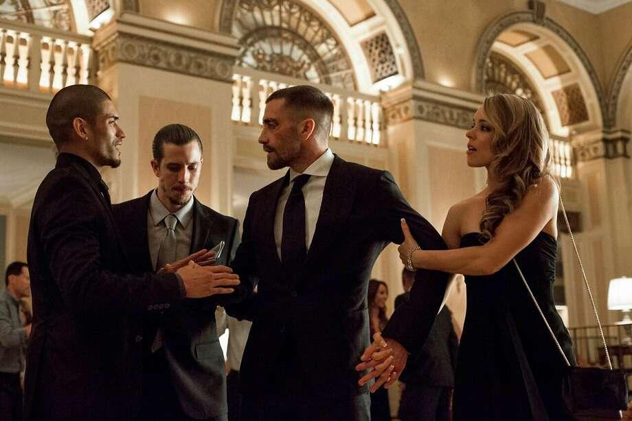 "From left, Miguel Gomez, Jake Gyllenhaal and Rachel McAdams star in ""Southpaw."" (Scott Garfield/The Weinstein Company) Photo: McClatchy-Tribune News Service"