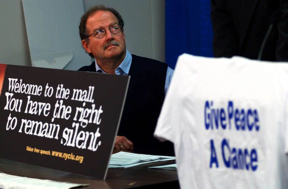 Times Union Staff photograph by Philip Kamrass -- Stephen Downs sits near the mock up of a billboard on I-90 to protest his recent arrest at Crossgate Mall for wearing a peace t-shirt, right, during a press conference to announce proposed legislation to protect speech and protests at malls, at the Legislative Office Building in Albany, NY Monday , March 31, 2003. FOR ALAN WECHSLER STORY. Photo: PHILIP KAMRASS / ALBANY TIMES UNION