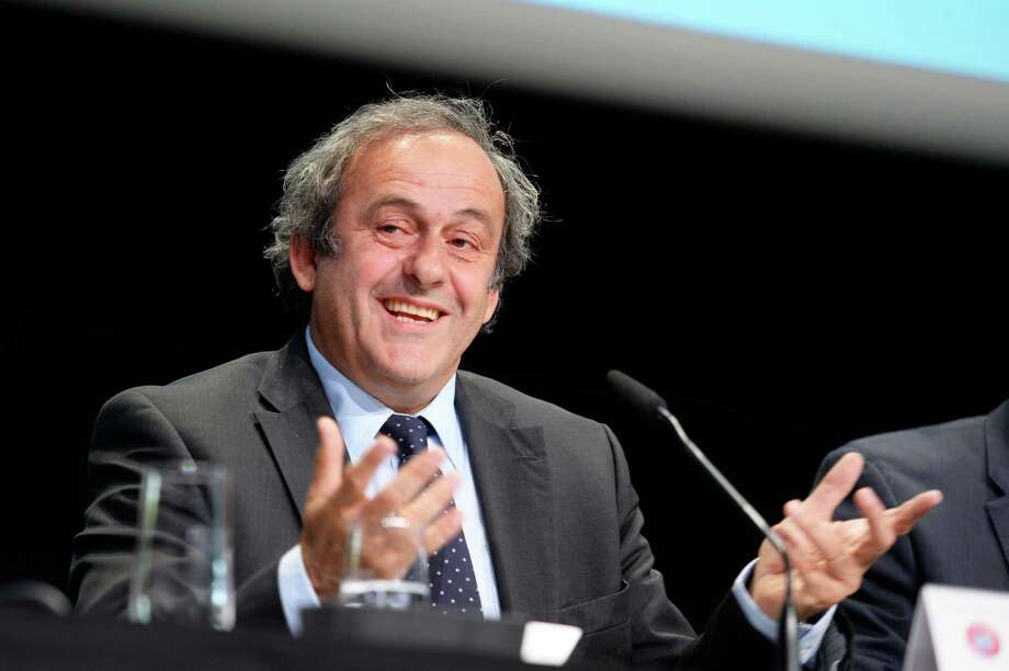 "FILE - In this May 28, 2015 file picture, UEFA-President Michel Platini speaks during a news  conference after a meeting of the European Soccer federation UEFA in Zurich, Switzerland. Michel Platini has launched his campaign to succeed Sepp Blatter as FIFA president, aiming to give the scandal-hit governing body ""the dignity and the position it deserves."" Platini, the UEFA president and a FIFA vice president, wrote to member federations in Europe on Wednesday July 29, 2015 saying he will stand in the election and is counting on their support.  (Walter Bieri/Keystone via AP,file) ORG XMIT: XBER103 Photo: Walter Bieri / KEYSTONE"