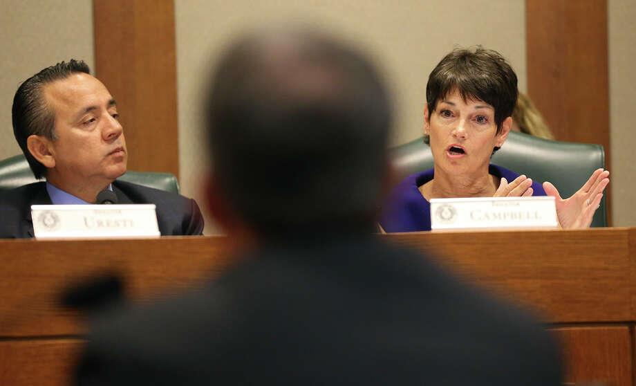Sen. Donna Campbell, R-New Braunfels, questions Attorney General Ken Paxton  as Sen. Carlos Uresti, D-San Antonio, listens. Photo: Tom Reel
