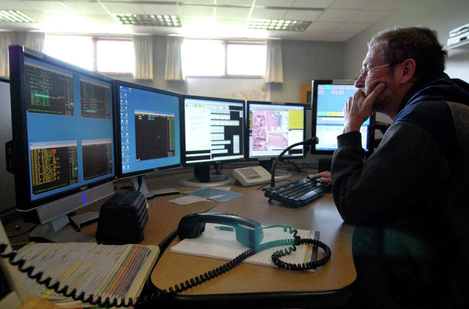 Emmett McGregor fields calls at the Albany County Sheriff's Department 911 dispatch center Friday, June 5, 2009, in New Scotland, N.Y.  (Will Waldron / Times Union archive) Photo: WILL WALDRON / 00004225A