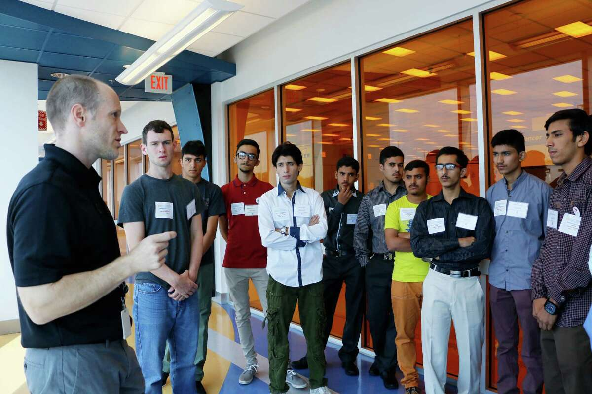 CNSE Associate Vice President Christopher Borst teaches Pakistani students from the Peshawar Army Public School in Pakistan about clean rooms on their tour of SUNY Polytechnic Institute?'s College of Nanoscale and Engineering (SUNY Poly CNSE) on Wednesday, July 29, 2015, in Albany, N.Y. (Olivia Nadel/ Special to the Times Union)