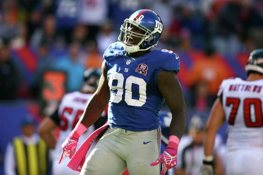 EAST RUTHERFORD, NJ - OCTOBER 05:  Defensive end Jason Pierre-Paul #90 of the New York Giants reacts after a play in the fourth quarter against the Atlanta Falcons during their game at MetLife Stadium on October 5, 2014 in East Rutherford, New Jersey.  (Photo by Elsa/Getty Images) ORG XMIT: 507868991 Photo: Elsa / 2014 Getty Images