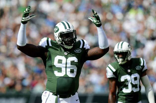 EAST RUTHERFORD, NJ - SEPTEMBER 28:   Muhammad Wilkerson #96 of the New York Jets reacts in the first quarter against the Detroit Lions at MetLife Stadium on September 28, 2014 in East Rutherford, New Jersey.  (Photo by Ron Antonelli/Getty Images) ORG XMIT: 504250045 Photo: Ron Antonelli / 2014 Getty Images