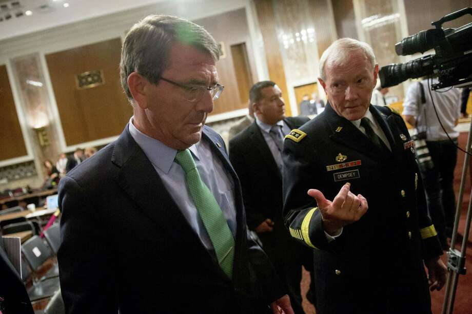 Defense Secretary Ash Carter talks with Joint Chiefs Chairman Gen. Martin Dempsey on Capitol Hill in Washington, Wednesday, July 29, 2015, after they testified before the Senate Armed Services Committee hearing on the impacts of the Joint Comprehensive Plan of Action (JCPOA) on U.S. Interests and the Military Balance in the Middle East. (AP Photo/Andrew Harnik) ORG XMIT: DCAH138 Photo: Andrew Harnik / AP