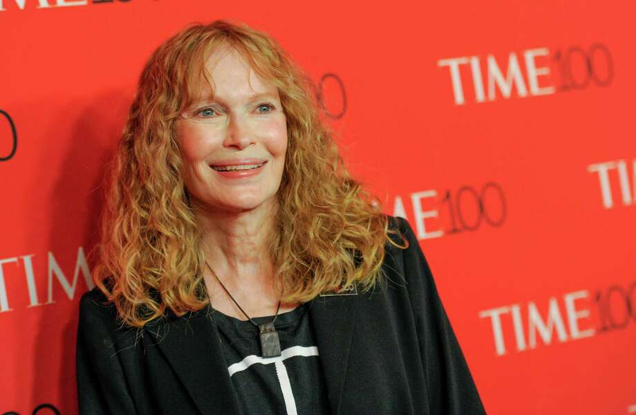 FILE - In this April 21, 2015 file photo, Mia Farrow attends the TIME 100 Gala in New York. Farrow took some Twitter heat Wednesday, July 29, for joining other angry social media posters and blasting out the business address of the dentist who killed the beloved lion Cecil in Zimbabwe. (Photo by Evan Agostini/Invision/AP, File) ORG XMIT: NYET326 Photo: Evan Agostini / Invision