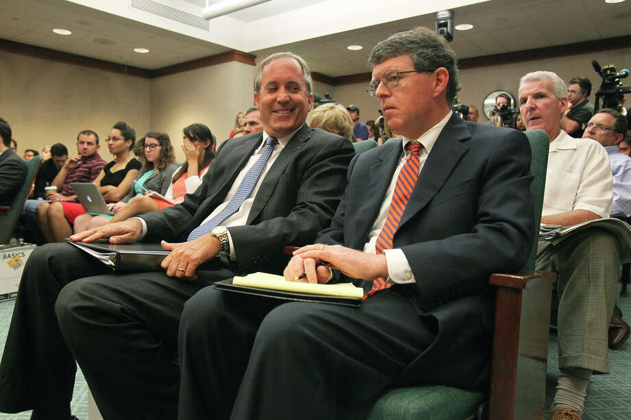 Texas Attorney General Ken Paxton waits with chief of staff Bernie McNamee prior to appearing before the Senate Health and Human Services Committee on July 29, 2015. Photo: Tom Reel / San Antonio Express-News