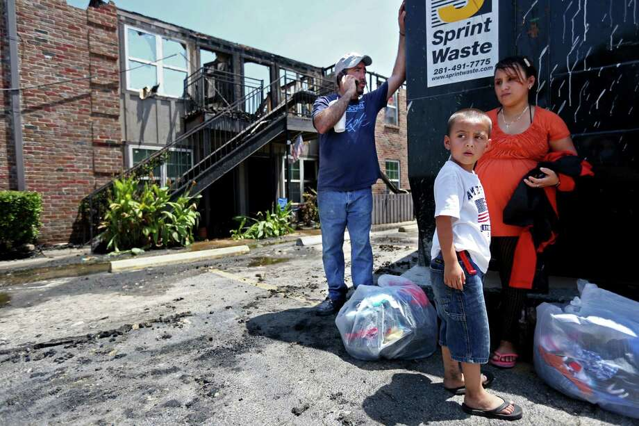 Misael Pineda, 38, his wife Maria Pineda, who is seven months pregnant, and their 5-year-old son Misael Pineda Jr., were burned out of their apartment. All their money burned in the fire, Misael Pineda, a construction worker, said. Photo: Gary Coronado, Staff / © 2015 Houston Chronicle