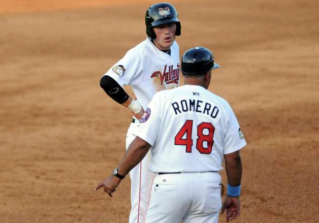 Tri-City ValleyCats manager Ed Romero talks with Bobby Wernes on third base during their game against the West Virginia Black Bears at Joe Bruno Stadium on Wednesday July 29, 2015 in Troy, N.Y. (Michael P. Farrell/Times Union) Photo: Michael P. Farrell / 00032765A