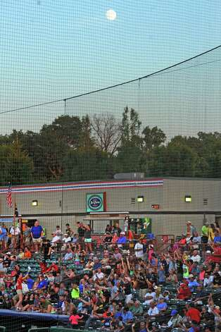 A waxing moon two days from full hangs above Joe Bruno Stadium as the Tri-City ValleyCats played against the West Virginia Black Bears on Wednesday July 29, 2015 in Troy, N.Y. (Michael P. Farrell/Times Union) Photo: Michael P. Farrell / 00032765A