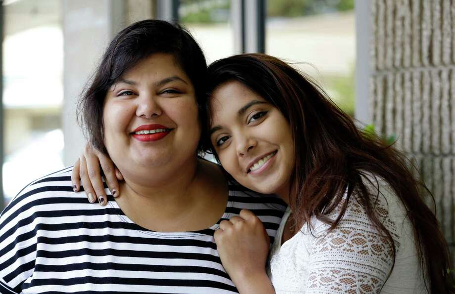 In this photo taken Thursday, July 23, 2015, Anjana Agarwal, left, poses with a photo with her daughter Aanya Nigam, 16, in Issaquah, Wash. After using an Internet-connected Amazon Echo digital assistant for two months, Aanya, 16, started to worry that the device was eavesdropping on conversations in her living room. So she unplugged the device and hid it in a place that her mother still hasn't been able to find. (AP Photo/Elaine Thompson) ORG XMIT: NYBZ302 Photo: Elaine Thompson / AP