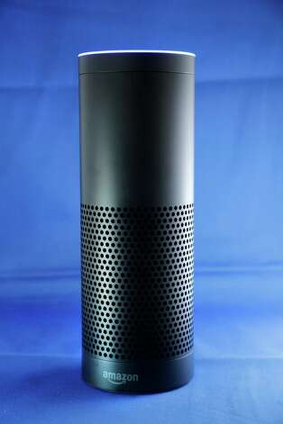 Amazon's Echo, a digital assistant that can be set up in a home or office to listen for various requests, such as for a song, a sports score, the weather, or even a book to be read aloud, is shown, Wednesday, July 29, 2015 in New York. The $180 cylindrical device is the latest advance in voice-recognition technology that's enabling machines to record snippets of conversation that are analyzed and stored by companies promising to make their customers' lives better. (AP Photo/Mark Lennihan) ORG XMIT: NYML301 Photo: Mark Lennihan / AP