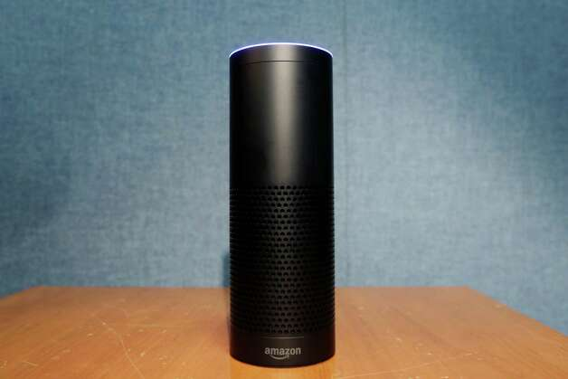 Amazon's Echo, a digital assistant that can be set up in a home or office to listen for various requests, such as for a song, a sports score, the weather, or even a book to be read aloud, is shown, Wednesday, July 29, 2015 in New York. The $180 cylindrical device is the latest advance in voice-recognition technology that's enabling machines to record snippets of conversation that are analyzed and stored by companies promising to make their customers' lives better. (AP Photo/Mark Lennihan) ORG XMIT: NYML305 Photo: Mark Lennihan / AP