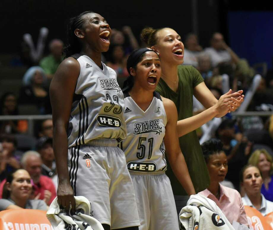 Sophia Young-Malcolm (33) and Sydney Colson  (51) react to the action on the court during WNBA action against Atlanta at Freeman Coliseum on Wednesday, July 29, 2015. Photo: Billy Calzada, Staff / San Antonio Express-News / San Antonio Express-News