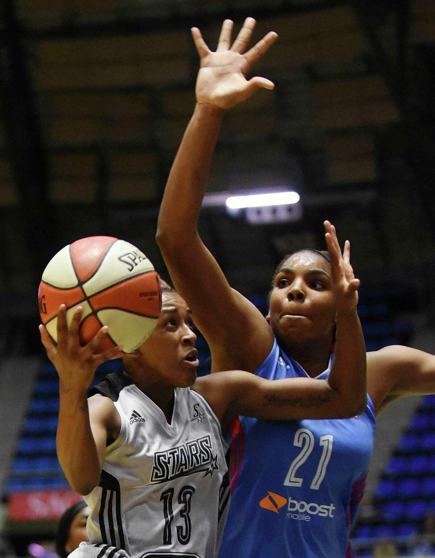 Danielle Robinson of the San Antonio Stars drives against Reshanda Gray of the Atlanta Dream during WNBA action at Freeman Coliseum on Wednesday, July 29, 2015.