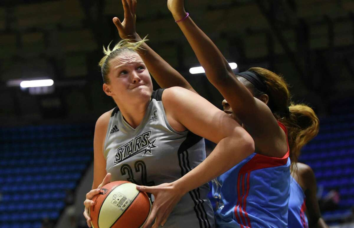 Jayne Appel of the San Antonio Stars muscles her way in the key as Reshanda Gray of the Atlanta Dream attempts to defend during WNBA action at Freeman Coliseum on Wednesday, July 29, 2015.