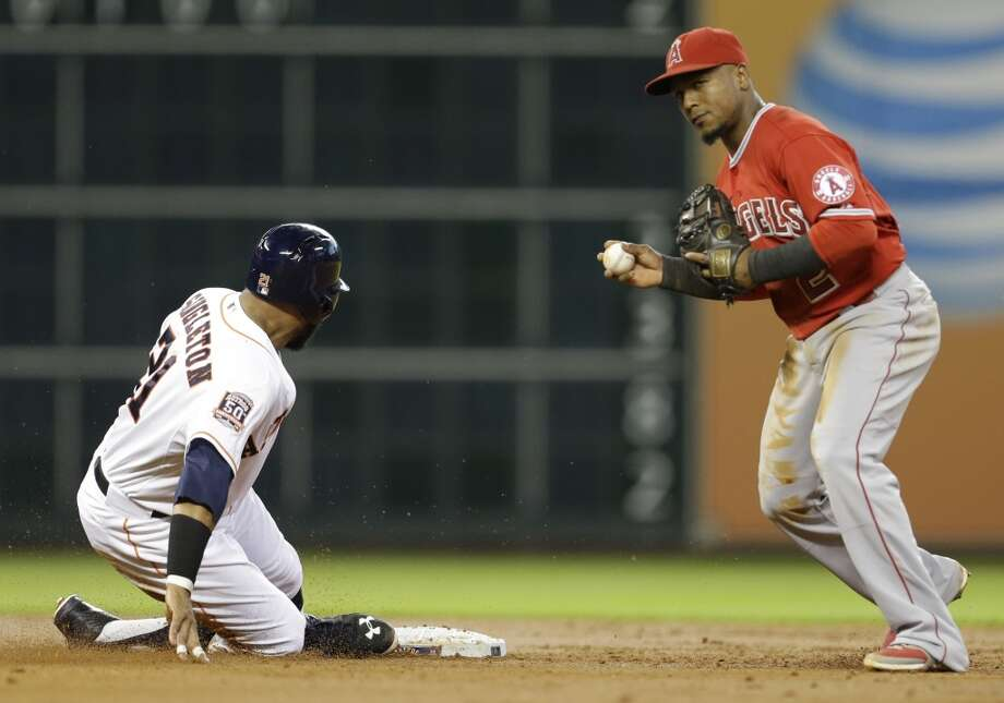 Astros Jon Singleton is out at second base against Los Angeles Angels Erick Aybar during the third inning at Minute Maid Park Wednesday, July 29, 2015, in Houston. Photo: Melissa Phillip, Houston Chronicle