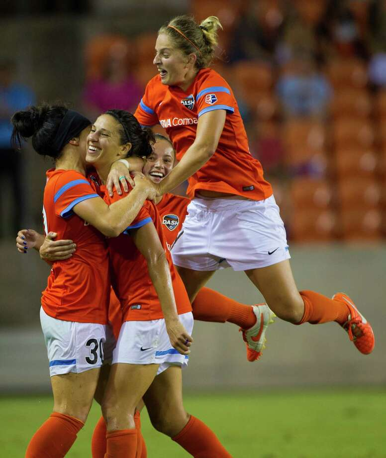 Carli Lloyd, second from left, is the object of affection of several teammates after scoring in the 87th minute Wednesday night. Photo: Marie D. De Jesus, Staff / © 2015 Houston Chronicle
