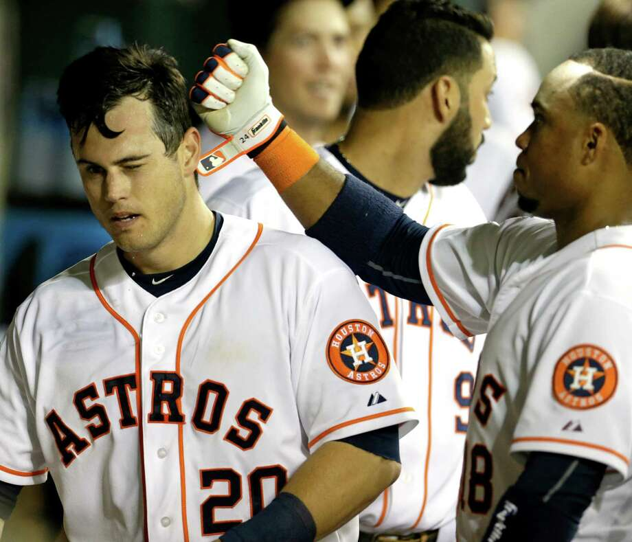 Astros outfielder Preston Tucker, left, celebrates with Luis Valbuena after the rookie's home run extended the Astros' lead against the Angels on Wednesday at Minute Maid Park. Photo: Melissa Phillip, Staff / © 2015 Houston Chronicle
