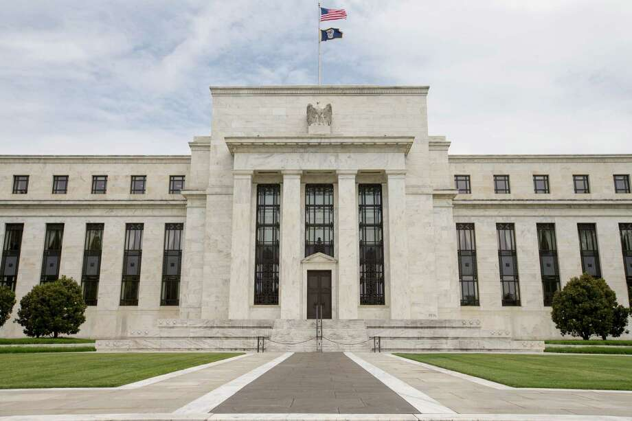 If Federal Reserve rates were higher, some oil speculation money would go elsewhere. Photo: Andrew Harnik, STF / AP