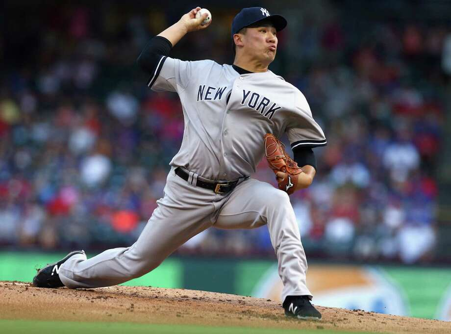 ARLINGTON, TX - JULY 29:  Masahiro Tanaka #19 of the New York Yankees pitches against the Texas Rangers in the bottom of the first ining at Globe Life Park in Arlington on July 29, 2015 in Arlington, Texas.  (Photo by Tom Pennington/Getty Images) ORG XMIT: 538587627 Photo: Tom Pennington / 2015 Getty Images