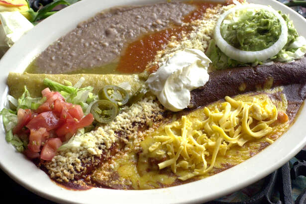 The Classic Enchilada Assortment at Los Barrios Mexican Restaurant includes five different types of enchiladas.