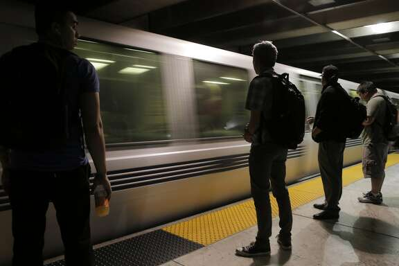 Passengers wait to board a west-bound BART train in the Embarcadero BART station in San Francisco, Calif., on Wednesday, July 29, 2015. BART shuts down the Transbay Tube for work on the West Oakland approach to the tube over the weekend of August 1st and 2nd. Trains will continue to run on either side of the bay, but will be turned around at Embarcadero station or from west Oakland, where the train descends into the tube.