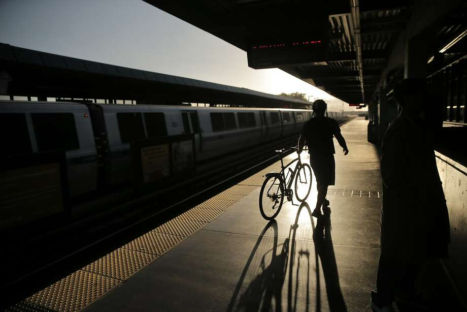 A BART passenger waits on the platform at West Oakland BART station for a west-bound train in Oakland, Calif., on Wednesday, July 29, 2015. BART shuts down the Transbay Tube for work on the West Oakland approach to the tube over the weekend of August 1st and 2nd. Photo: Carlos Avila Gonzalez, The Chronicle