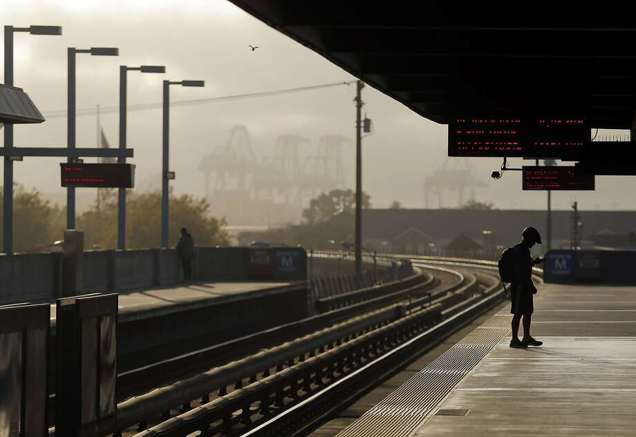 A BART passenger waits on the platform at West Oakland BART station for a west-bound train in Oakland, Calif., on Wednesday, July 29, 2015. BART shuts down the Transbay Tube for work on the West Oakland approach to the tube over the weekend of August 1st and 2nd. Trains will continue to run on either side of the bay, but will be turned around at Embarcadero station or from west Oakland, where the train descends into the tube. Photo: Carlos Avila Gonzalez, The Chronicle