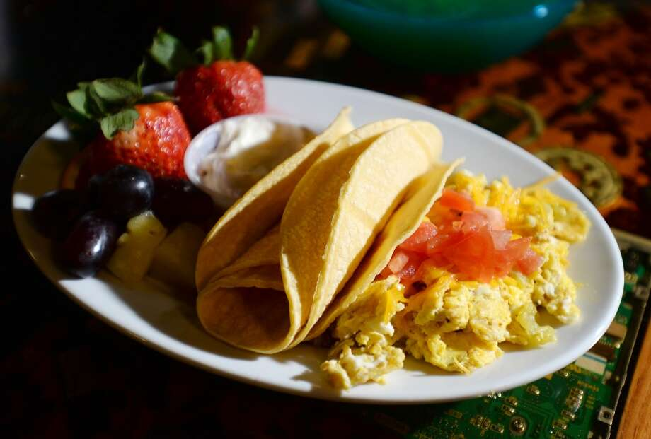 Pictured is a plate of migas -- scrambled eggs mixed with crunchy corn tortillas, mild peppers, cheese and diced tomatoes -- from the brunch menu at Logon Cafe, shot on Saturday, April 12, 2014. Brunch entrees come with a choice of fresh fruit or hash browns.  Photo taken Saturday, 4/12/14 Jake Daniels/@JakeD_in_SETX
