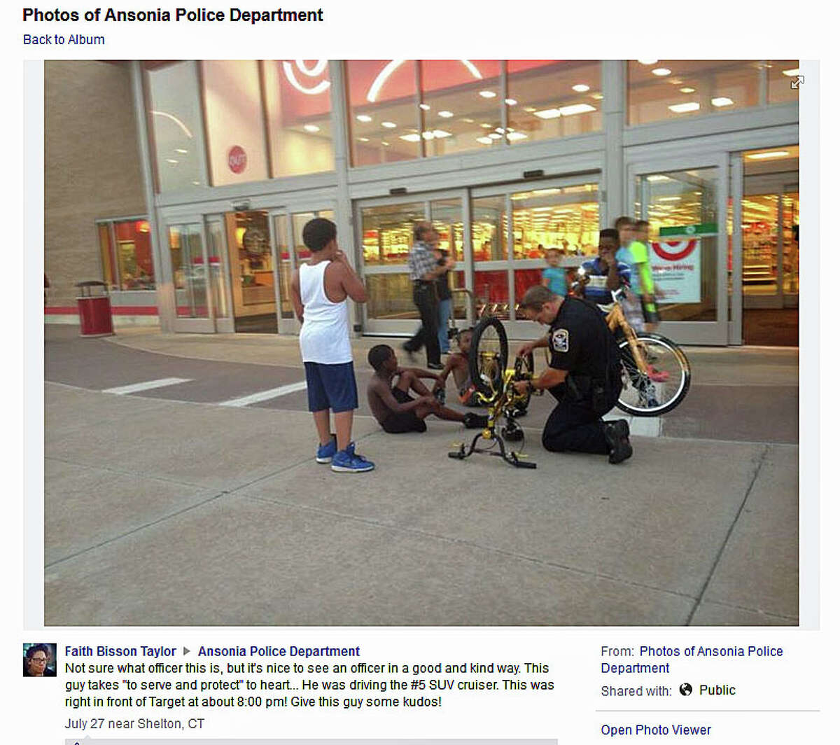 This photo shot by Faith Taylor and posted on the Ansonia Police Facebook page shows Officer Michael Castillo fixing a bicycle chain in front of the Target store in Ansonia.