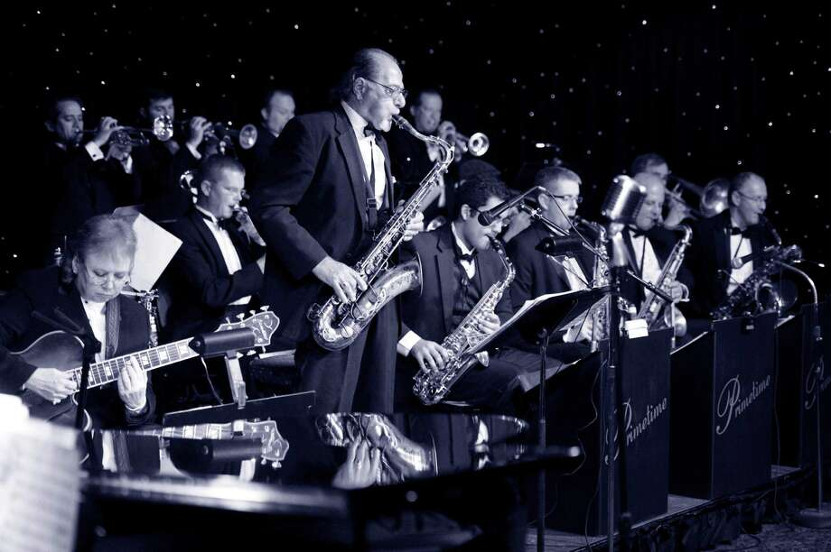 The Primetime Jazz Orchestra has marked 10 years of performances at the Cove, though they wear T-shirts, not suits. Photo: File Photo