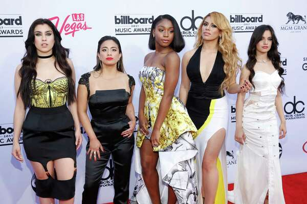 Lauren Jauregui ( from left) Ally Brooke, Normani Hamilton, Dinah-Jane Hansen, and Camila Cabello of the musical group Fifth Harmony arrive at the Billboard Music Awards at the MGM Grand Garden Arena on May 17, 2015, in Las Vegas.