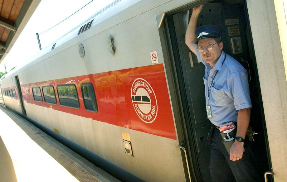 Paul Holland a conductor with the Metro North train as the train departs from Danbury to Norwalk. Photo: File Photo/ Wendy Carlson / File Photo / The News-Times File Photo
