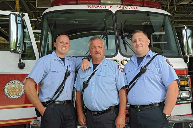 Captain David Stevens, center, stands in front of the rescue squad truck with his sons David Jr., left, and Sean at the Troy Fire Department central fire station on Wednesday, July 29, 2015 in Troy, N.Y. Stevens is retiring after more than 30 years with Troy Fire Department assigned to the rescue squad. His sons also work at the fire station. (Lori Van Buren / Times Union) Photo: Lori Van Buren / 10032817A