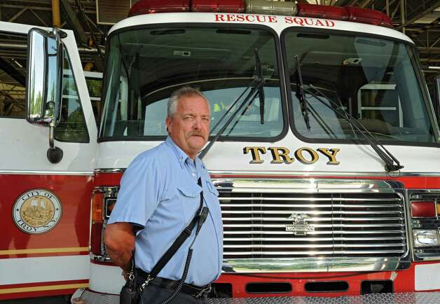 Captain David Stevens stands in front of the rescue squad truck at the Troy Fire Department central fire station on Wednesday, July 29, 2015 in Troy, N.Y. Stevens is retiring after more than 30 years with Troy Fire Department assigned to the rescue squad. (Lori Van Buren / Times Union) Photo: Lori Van Buren / 10032817A