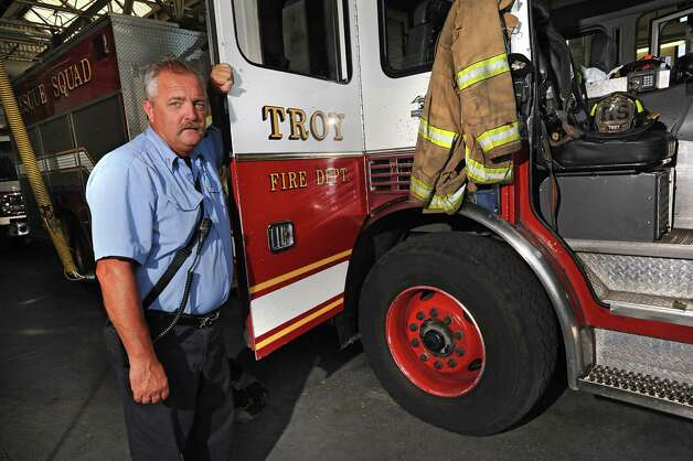 Captain David Stevens stands next to the rescue squad truck at the Troy Fire Department central fire station on Wednesday, July 29, 2015 in Troy, N.Y. Stevens is retiring after more than 30 years with Troy Fire Department assigned to the rescue squad. (Lori Van Buren / Times Union) Photo: Lori Van Buren / 10032817A