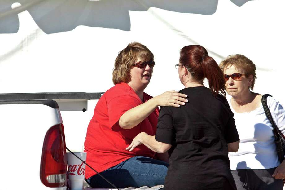 A woman who identified herself only as a friend of the family talks to Laura Wilkerson, mother of Joshua Wilkerson, as Texas Equusearch assists the Pearland Police Department during a search for the 18-year-old who disappeared on Tuesday, November 16, 2010.  Photo: Eric Kayne, For The Chronicle / Freelance