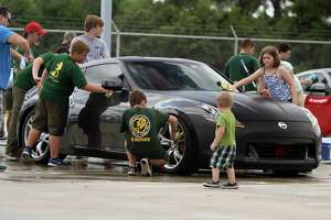 Fred Haas Nissan hosts Tomball Boy Scouts' car wash event - Photo