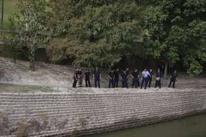 Body found floating in downtown bayou - Photo