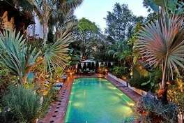 """""""The Big Bang Theory"""" star Johnny Galecki just purchased this $9.2 million Hollywood Hills villa from actor Jason Statham, who previously purchased the home from Ben and Christine Stiller, according to Zillow. The home, built in 1929, encompasses six bedrooms, six bathrooms, a library, an office, a screening room, a guest house, a pergola-shaded patio, and outdoor dining space."""